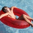 Relaxed child in the pool — Stock Photo #9432402