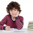 Adorable child writing in the school — Stock Photo #9432479