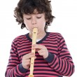 Adorable child playing flute — Stock Photo #9432482