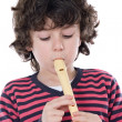 Adorable child playing flute — Stock Photo #9432483