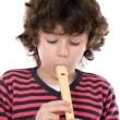Adorable child playing flute — Stock Photo #9432486