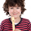 Adorable child playing flute — Stock Photo #9432488
