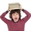 Adorable child with many books on the head - Stock Photo