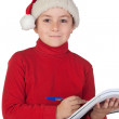 Beautiful child writing his Christmas letter — Stock Photo
