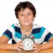 Adorable boy with a alarm-clock — Stock Photo