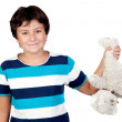 Adorable boy picking up a teddy bear — Stock Photo
