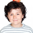 Beautiful child with a apple on his head — Stock Photo