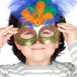 Funny boy with carnival mask - Stock Photo