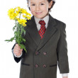 Adorable boy with flowers — Stock Photo #9432693