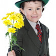 Adorable boy with flowers — Stock Photo #9432695