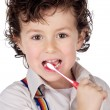 Adorable boy child cleaning the teeth — Stock Photo #9432775