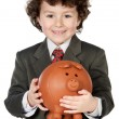 Adorable child with its savings in its money box of piggy — Stock Photo #9432783