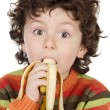 Child eating a banana — Stock Photo