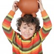 Boy with the full head of savings — Stock Photo