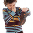 Boy with stinky  shoe - Foto Stock