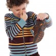 Boy with stinky  shoe - Stock Photo