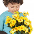 Adorable child with flowers - Stock Photo