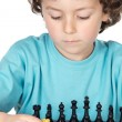 Boy playing the chess — Stock Photo #9432924