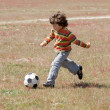 Child playing football — Stok fotoğraf