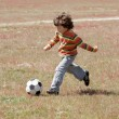 Child playing football — Stock fotografie