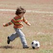 Stock Photo: Child playing football