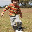 Child playing football — Stock Photo