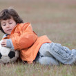 Child playing with a soccer ball — Stock Photo #9432951