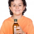 Nice child with olive oil bottle — Stock Photo #9432967