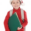 Child studying with Santa Claus hat — Stock Photo #9433020