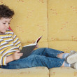 Adorable boy reading — Stock Photo #9433053