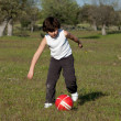 Small child playing soccer — Stock Photo