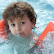 Adorable boy learning to swim — Stock Photo #9433100