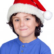 Funny child with Santa hat — Stock Photo #9433126