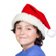 Funny child with Santa hat — Stock Photo #9433130