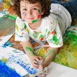 Boy playing with painting — Stock Photo #9433252