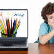 Foto Stock: Child whit laptop