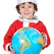 Santa boy with globe — Stock Photo #9433275