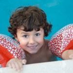 Boy learning to swim — Stock Photo #9433280