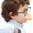 Adorable boy with glasses and nose of toy — Stock Photo #9433284