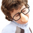Adorable boy with glasses and nose of toy — Stock Photo #9433285