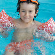 Little boy learning to swim - Stock Photo