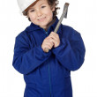 Adorable boy dressed worker in a hammer and a helmet — Stock Photo #9433305