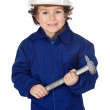Adorable boy dressed worker in a hammer and a helmet — Stock Photo #9433306