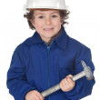 Adorable worker child with a hammer — Stock Photo #9433307