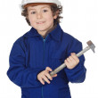 Adorable boy dressed worker in a hammer and a helmet — Stock Photo #9433308