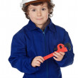 Adorable boy dressed worker in a hammer and a helmet — Stock Photo #9433309