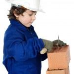 Adorable future builder constructing a brick wall — Stock Photo #9433343