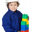 Adorable future builder constructing a brick wall with toy piece — Stock Photo #9433357