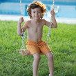 Child  playing in a swing — Stock Photo