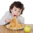 Adorable child hungry at the time of eating — Stock Photo